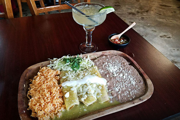 image of enchiladas verdes by Amelia's