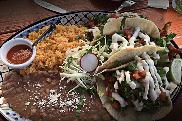image of fish tacos by Amelia's