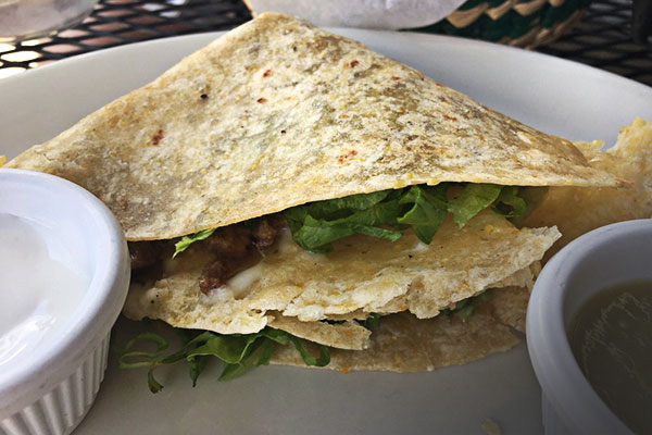 image of single quesadilla at happy hour